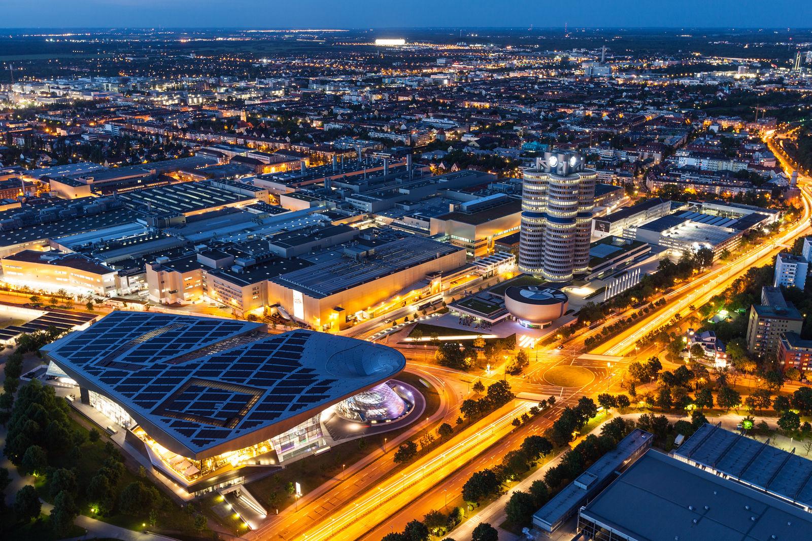 Aerial view of BMW Museum and BWM Welt and Munich from Olympic Tower in the evening on May 11, 2012 in Munich, Bavaria, Germany