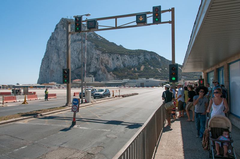 Locals and tourists on a side walk in runway - Gibraltar