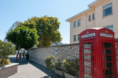 Red telephone booth on a side walk in Gibraltar