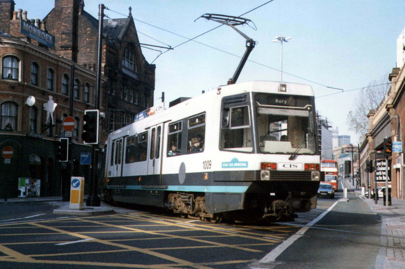 Manchester Metrolink tram 1009 leaving Piccadilly station and crossing London Road during 1992