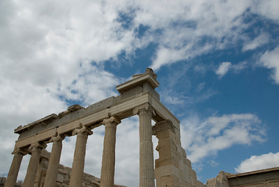 Ruins of the Acropolis of Athens against the clouds in Greece