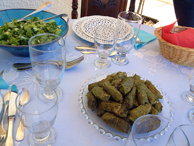 Vine leaves stuffed with rice and lettuce salad