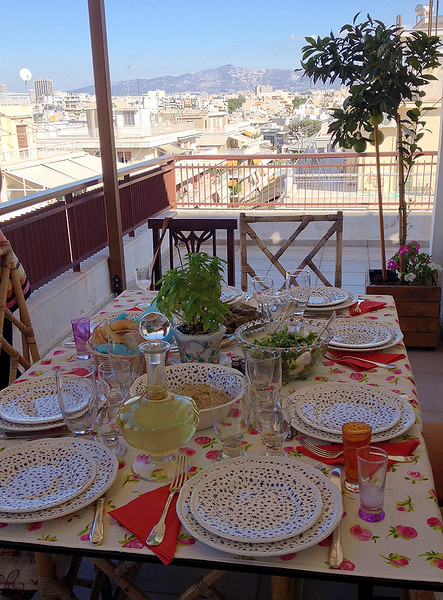 The pretty table is set on Eleni's balcony