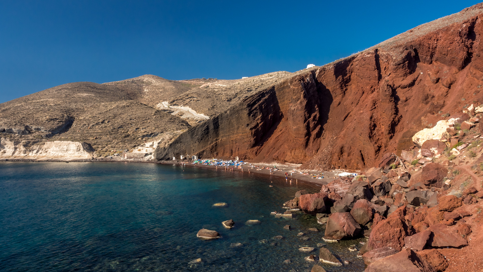 Take some time to explore the Red Beach as well.