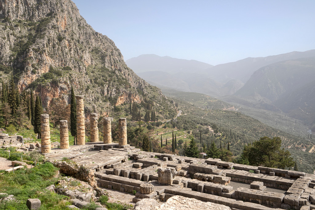 Ancient Temple of Apollo, Delphi, Greece with mountain view