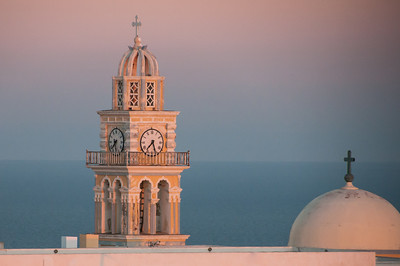 The top of the Catholic Cathedral in Santorini at sunset.