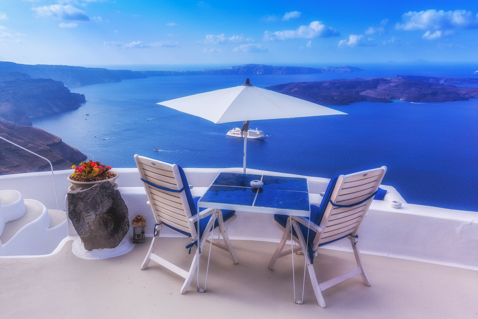 A perfect seat to watch the ships come into the harbour in Santorini.