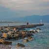 fisherman on seawall near Monemvasia