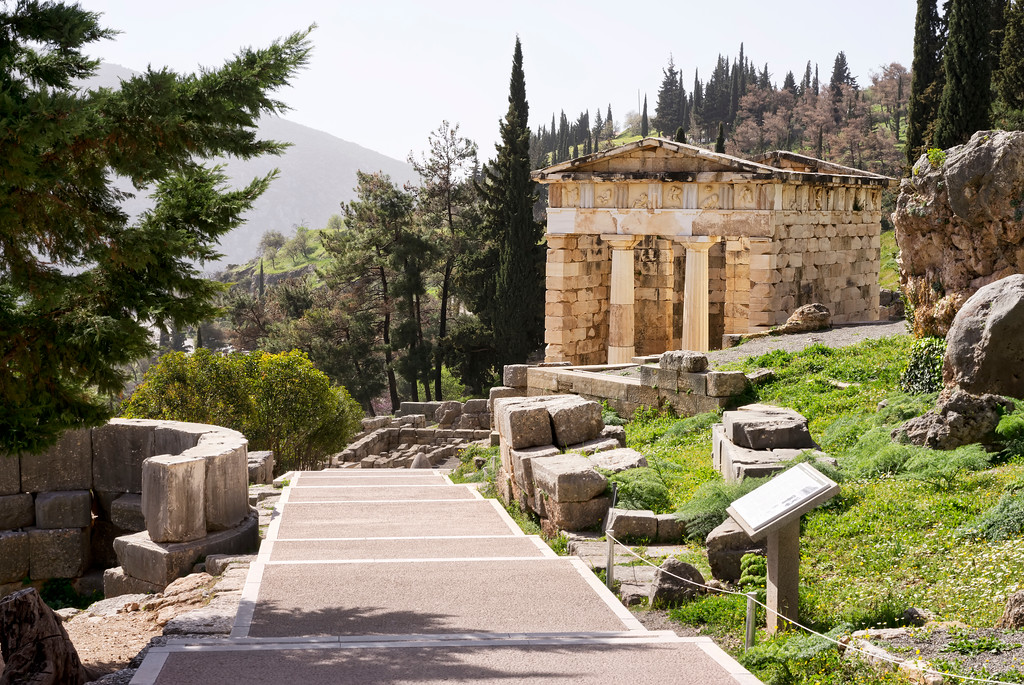 Treasury of the Anthenians and sacred way at Delphi, Greece.