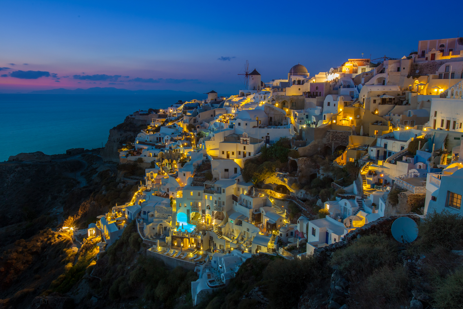 The city of Oia at Sunset on the island of Santorini.