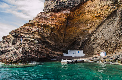 A small church at the base of the cliffs on Santorini