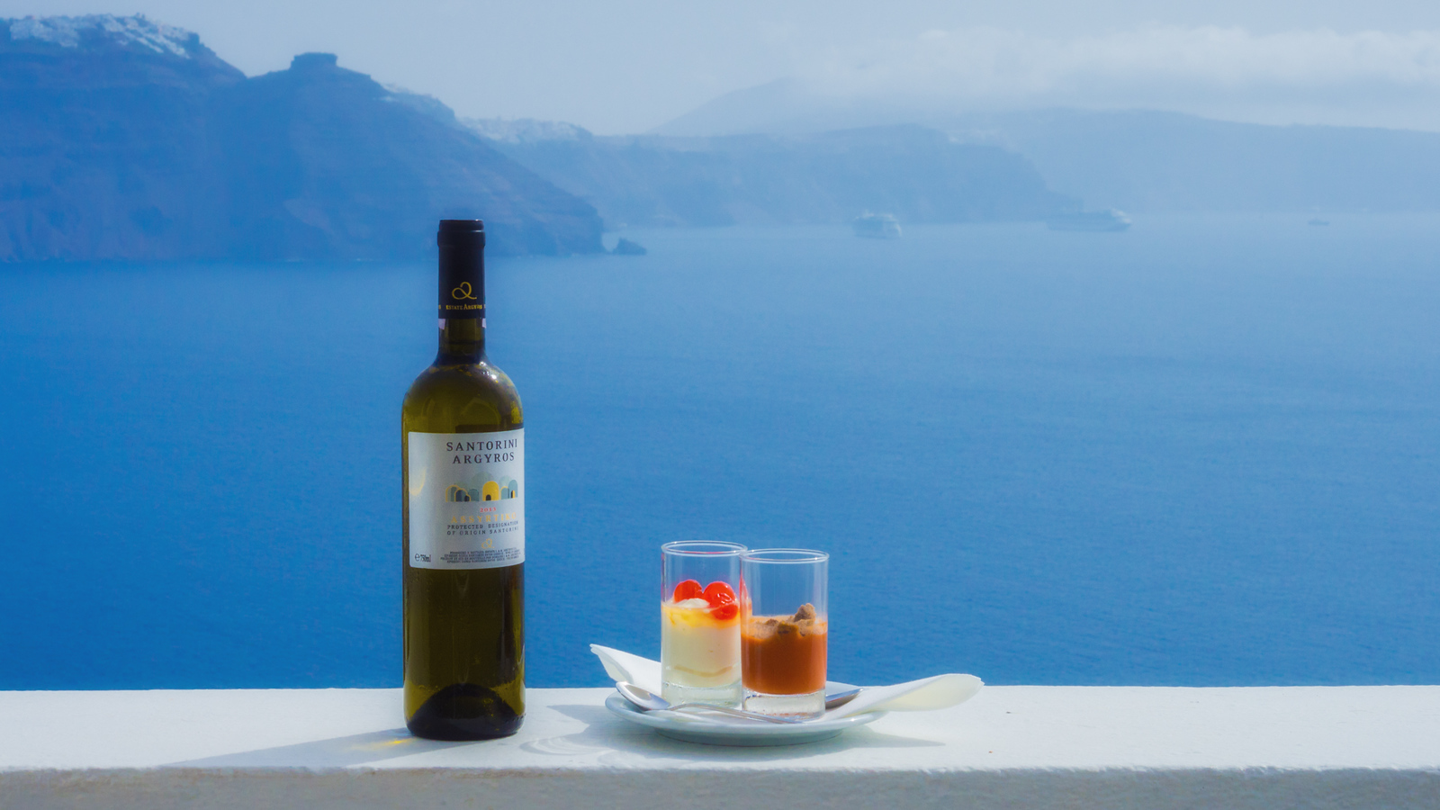 Even the food and wine come with a view in Santorini