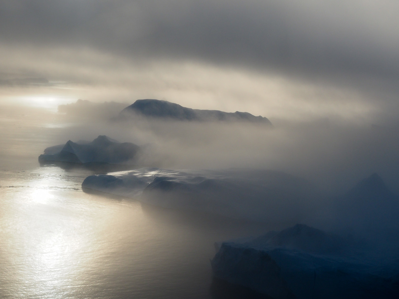 Sea fog over the icebergs in Ilulissat
