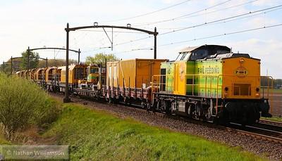 202-819 (92-84-2203-018) passes Gilze Rijen with a rail grinder set 01/05/15  Watch the video at: https://youtu.be/PFM8X_PVulk