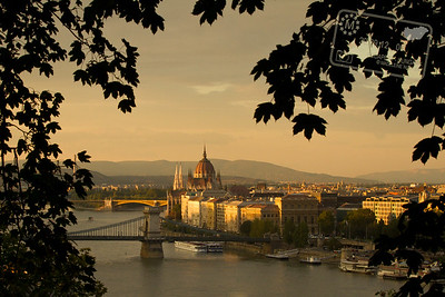 Peeking through the trees looking towards Budapest's Parliament on Gellert Hill during the last hours of sunset. One of my favorite views from this trip. Oh, Budapest. I do like you.
