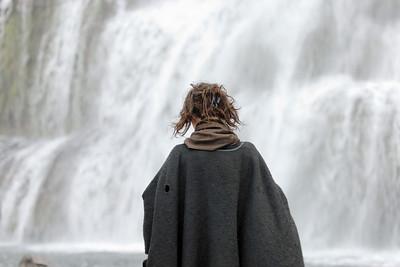 West Fjords - Woman meditating at Dynjandi falls