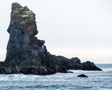 Start lava formations poking up out of the waves