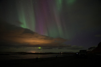 And of course the many colors of the aurora mixed here with the reflected street lights on the bottom of the clouds
