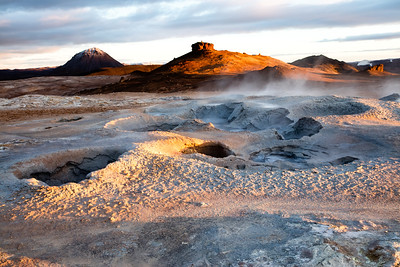 Steaming volcanic vents in the early morning sun near Hverir