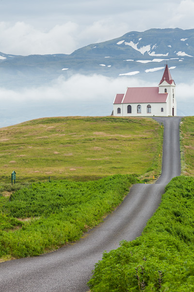 Ingjaldshóll og Snæfellsjökull - Ingjaldsholl Church. Snaefellsjokull in background. Ingjaldshóll, a church, ancient manor farm and the main setting of Víglundar saga. Often the residence of sheriffs and other important officials. The church is believed to be the oldest concrete church in the world, built in 903. A painting in the church by Áki Gränz shows Christopher Columbus conversing with the local clergyman in 1477 about the voyages of Icelanders to the west (Vinland – now Ameria).
