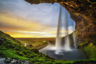 Sunset over the famous Seljalandsfoss Waterfall  in Iceland