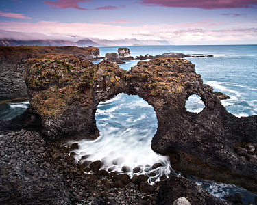 It's a rough and rocky coastline with many eroded arches.