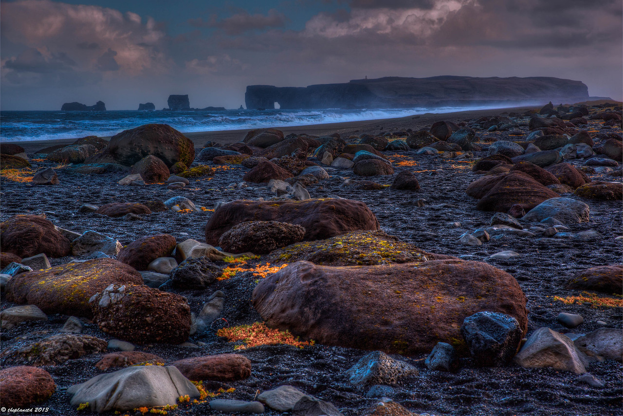 Weather can change in an instant on the beaches of Vik in Southern Iceland