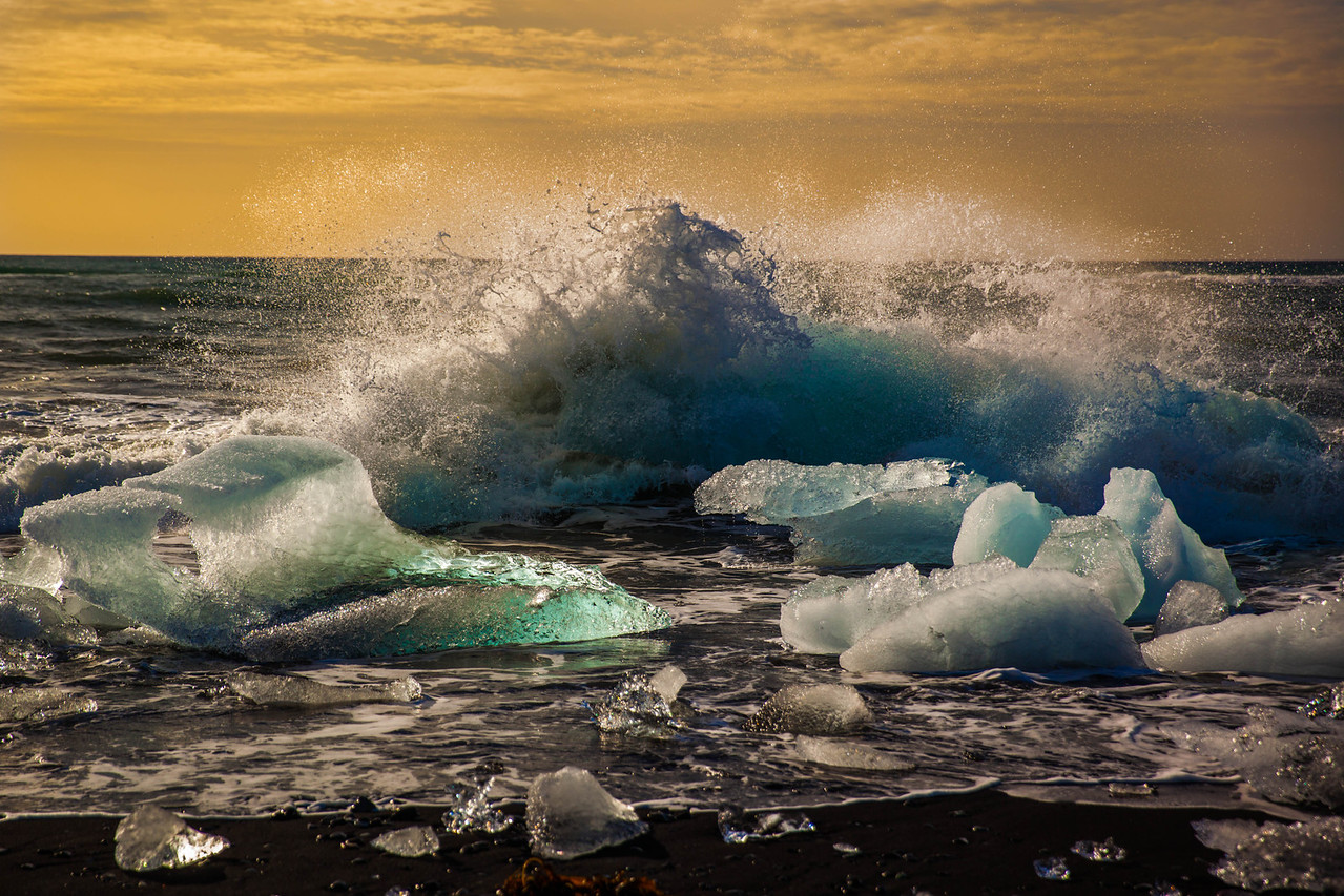 waves crashing on ice in iceland