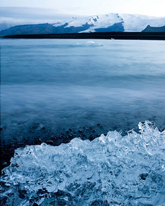 Ice from the glacial lagoon melting on the beach in early morning
