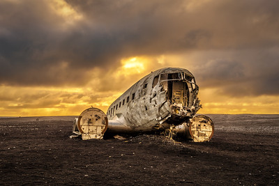 Old crashed plane in Iceland with heavy storm clouds