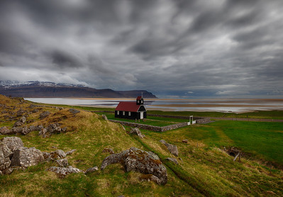 A small church and graveyard on an isolated stretch of coast in Iceland