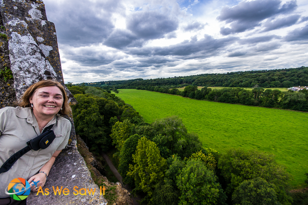 Linda on Blarney Castle ramparts with view of surrounding grounds