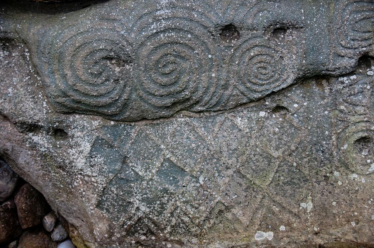 Carvings on stone walls of Newgrange in County Meath, Ireland