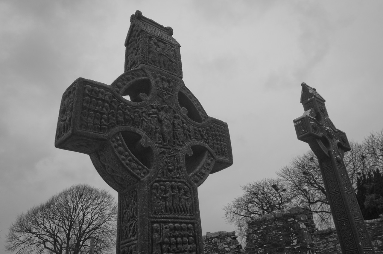 Close-up shot of cross at a grave site in B&W - County Clare, Ireland