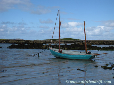 Tide coming in on a beached boat on the West Coast of Ireland.