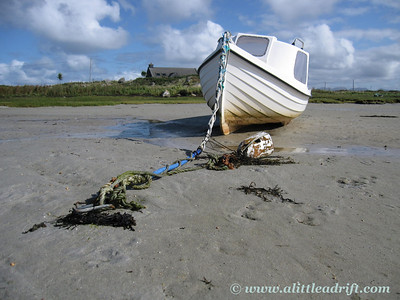 Boat tethered to Sand