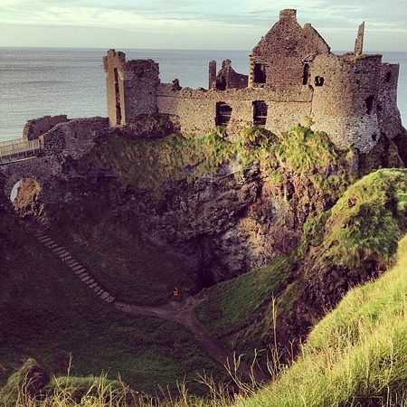 Late afternoon light, the ruins of Dunluce Castle, borne of turbulent history and family feuds along the coastal causeway. #dna2ireland
