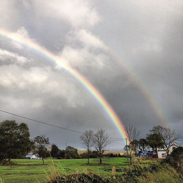 "Two rainbows. Must be a sweet pot of gold in that house. County Sligo, Ireland. In the words of a woman from Mayo, ""I have no scientific proof for this, but I swear that the further north you go in this country, the brighter the rainbows get."" #dna2irelan"