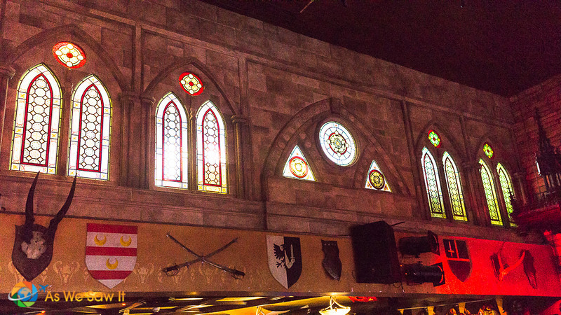 The top level of Kyteler's Inn has arched, stained glass windows and medieval decor.