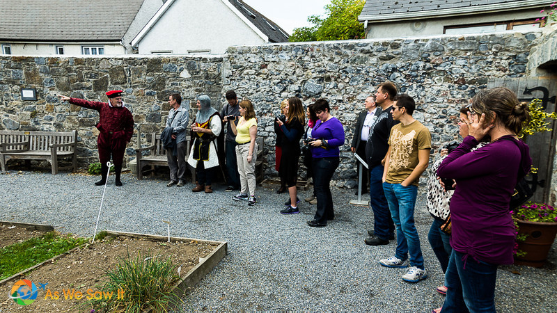 Standing in the garden, John Rothe tells his audience more about his house.