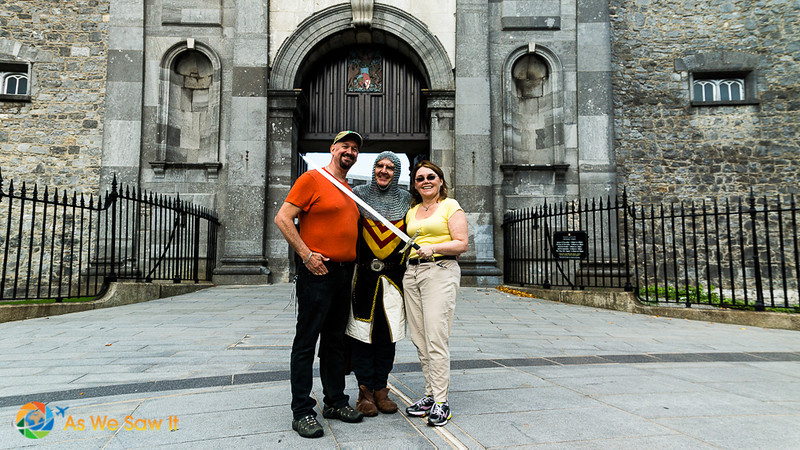 Linda and Dan pose with Sir Mike and his sword in front of the entrance to Kilkenny Castle