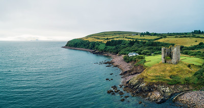 Aerial panorama of the Minard Castle situated on the Dingle Peninsula in Ireland