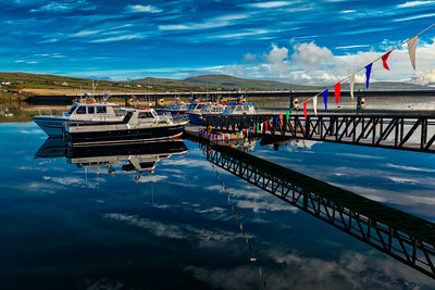 Sunrise Reflections at Portmagee Harbour in Ireland.