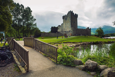 Path and footbridge leading to Ross Castle in Ireland