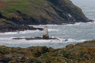 Lighthouse tower in the middle of the sea in Isle of Man