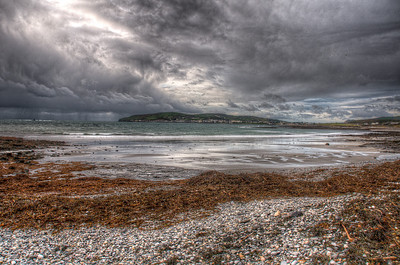 Wide shot of the beach along the coast of Isle of Man