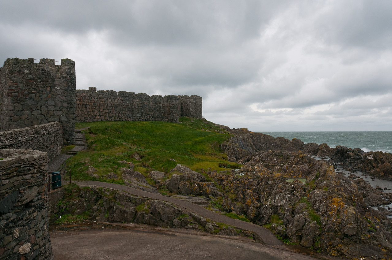 Ancient fortress and rocky cliffs in Isle of Man