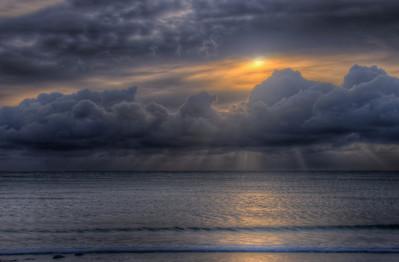 Beautiful sunset streaking through clouds in Isle of Man