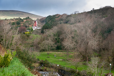 The Laxey Wheel peeking out through the canopy in Isle of Man