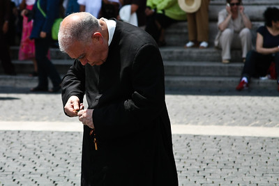Vatican Priest Winds His Watch